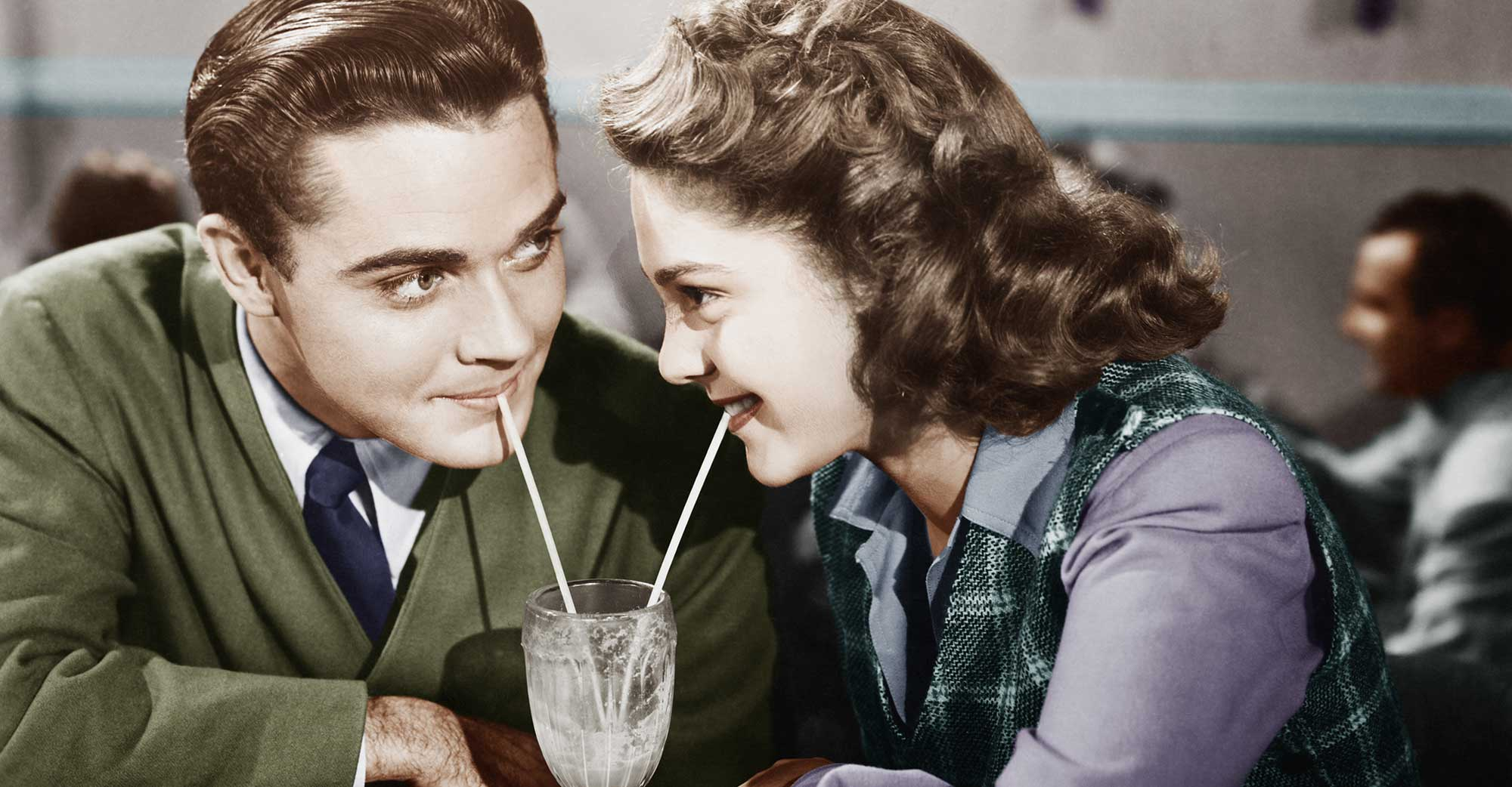 Couple Drinking Together Using Straws